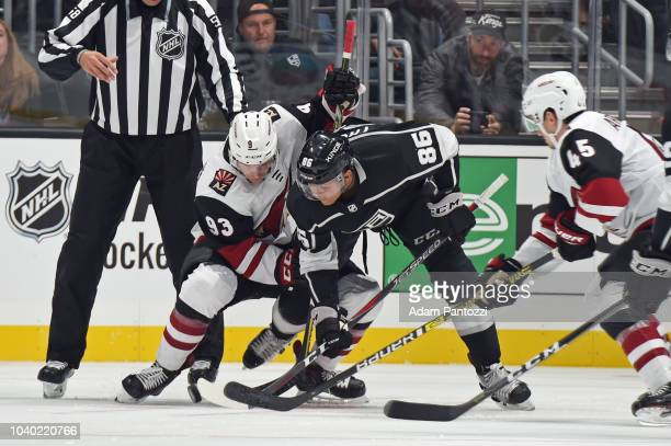 Akil Thomas of the Los Angeles Kings battles for the puck against Lane Pederson of the Arizona Coyotes during a preseason game at STAPLES Center on...