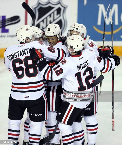 Akil Thomas of the Niagara IceDogs celebrates a goal with teammates during the first period of an OHL game against the Barrie Colts at Meridian...