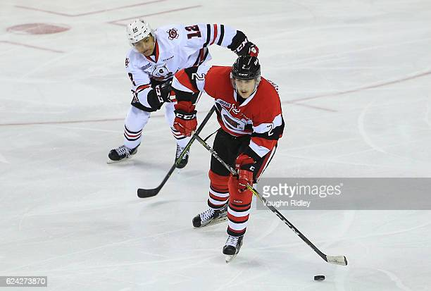 Akil Thomas of the Niagara IceDogs chases Noel Hoefenmayer of the Ottawa 67's during the second period of an OHL game at the Meridian Centre on...