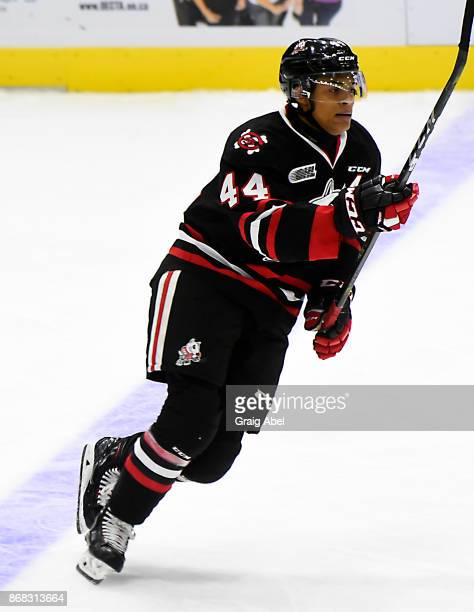 Akil Thomas of the Niagara IceDogs skates up ice against the Mississauga Steelheads during game action on October 29 2017 at Hershey Centre in...