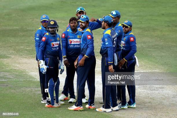 Akila Dananjaya of Sri Lanka celebrate with teammates after dismissing Mohammad Hafeez of Pakistan during the first One Day International match...