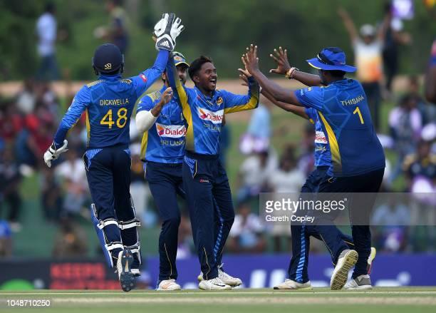 Akila Dananjaya of Sri Lanka celebrates dismissing Jason Roy of England during the 1st One Day International match between Sri Lanka and England at...