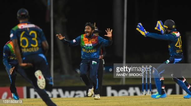 Akila Dananjaya of Sri Lanka celebrates the dismissal of Nicholas Pooran of West Indies during a T20i match between Sri Lanka and West Indies at...