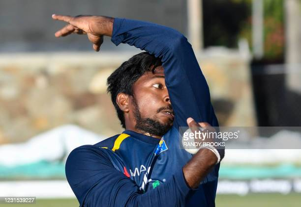 Akila Dananjaya of Sri Lanka warms up before the start of the 2nd T20i match between Sri Lanka and West Indies at Coolidge Cricket Ground on March 5...