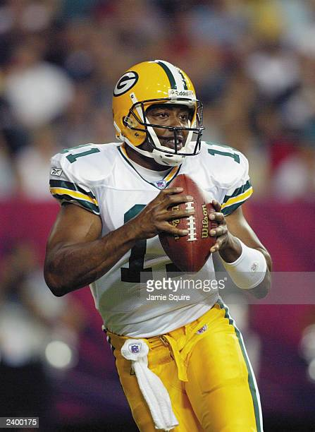 Akili Smith of the Green Bay Packers drops back to pass against the Atlanta Falcons on August 9 2003 at the Georgia Dome in Atlanta Georgia The...