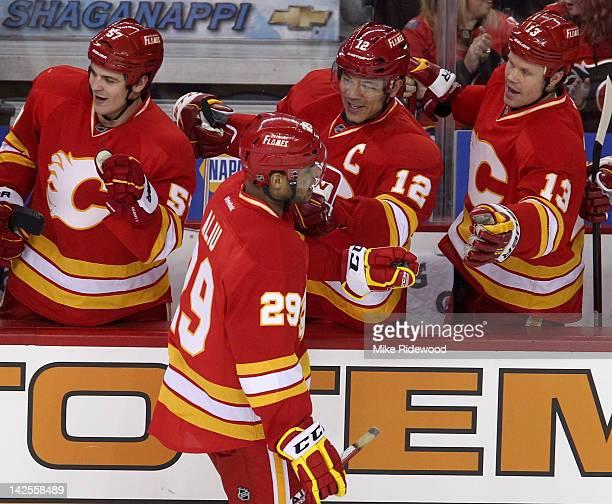 Akim Aliu of the Calgary Flames celebrates his first NHL goal with Lance Bouma Jarome Iginla and Olli Jokinen of the Calgary Flames against the...