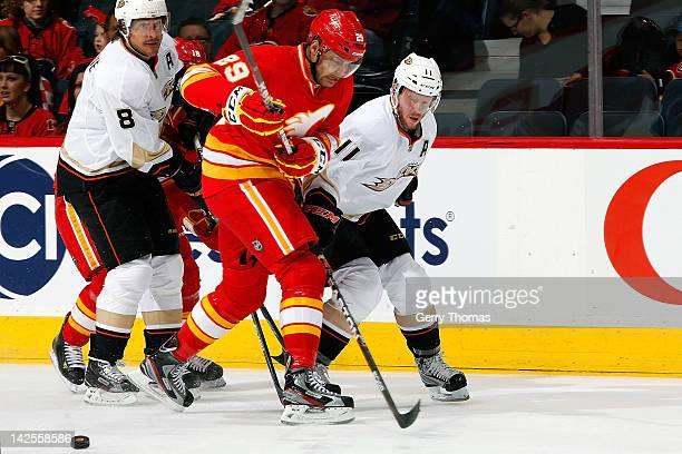 Akim Aliu of the Calgary Flames skates against Teemu Selanne and Saku Koivu of the Anaheim Ducks on April 7 2012 at the Scotiabank Saddledome in...
