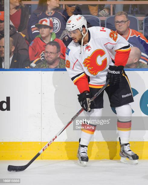 Akim Aliu of the Calgary Flames skates against the Edmonton Oilers during an NHL game at Rexall Place on April 13 2013 in Edmonton Alberta Canada