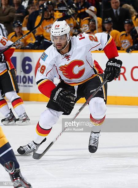 Akim Aliu of the Calgary Flames skates against the Nashville Predators during an NHL game at the Bridgestone Arena on April 23 2013 in Nashville...
