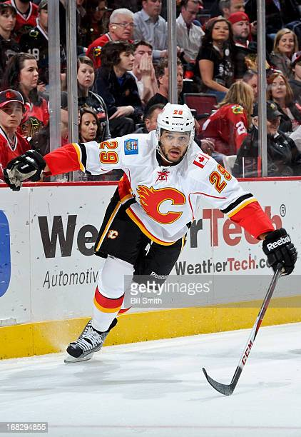 Akim Aliu of the Calgary Flames skates around the boards during the NHL game against the Chicago Blackhawks on April 26 2013 at the United Center in...