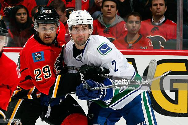 Akim Aliu of the Calgary Flames skates in his first NHL game against Dan Hamhuis of the Vancouver Canucks on April 5 2012 at the Scotiabank...