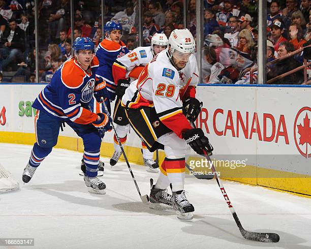 Akim Aliu of the Calgary Flames skates with the puck against the Edmonton Oilers during an NHL game at Rexall Place on April 13 2013 in Edmonton...