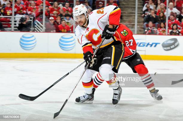 Akim Aliu of the Calgary Flames watches for the puck during the NHL game against the Chicago Blackhawks on April 26 2013 at the United Center in...