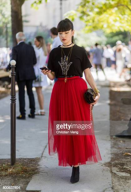 Akimoto Kozue wearing a red maxi skirt black tshirt outside Dior Homme during Paris Fashion Week Menswear Spring/Summer 2018 Day Four on June 24 2017...