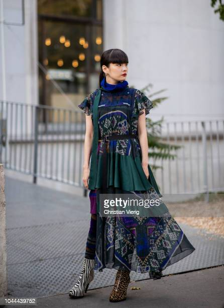 Akimoto Kozue wearing dress with print is seen outside Sacai during Paris Fashion Week Womenswear Spring/Summer 2019 on October 1 2018 in Paris France