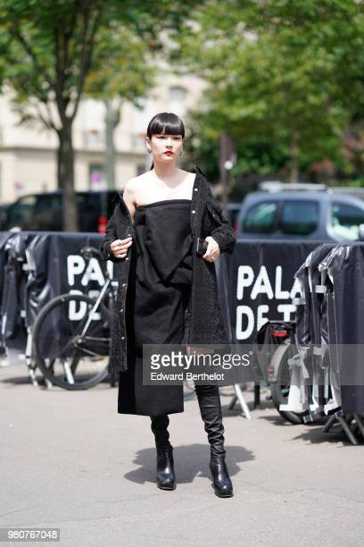 Akimoto Kozue wears a black coat a black dress black boots outside Rick Owens during Paris Fashion Week Menswear SpringSummer 2019 on June 21 2018 in...