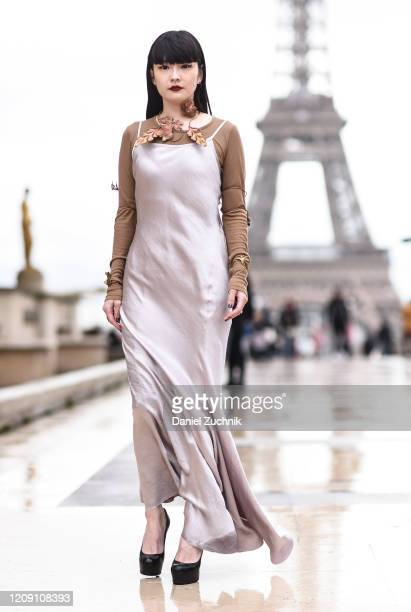 Akimoto Kuzue is seen wearing an Ann Demeulemeester dress with leaf plated jewelry outside the Ann Demeulemeester show during Paris Fashion Week AW20...