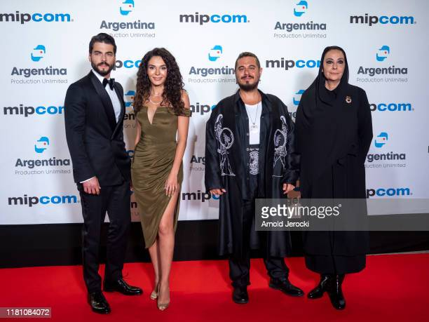 Akin Akinozu Ebru Sahin guest and Ayda Aksel attends the opening ceremony of MIPCOM 2019 on October 14 2019 in Cannes France