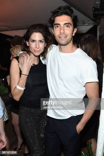 Akin Akman and guest attend the Artsy Projects Miami x Gucci Special Thanks to Bombay Sapphire at The Bath Club on December 6 2017 in Miami Beach...