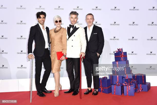 Akin Akman Maye Musk Eric Rutherford and Trey Laird attends Swarovski Crystal Wonderland Party on September 20 2017 in Milan Italy