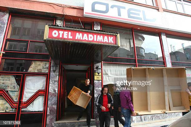 AKINCIEmployees of the Madimak Hotel hotel in the eastern Turkish city of Sivas empty the building on December 1, 2010. In 1993, 37 Alawite...