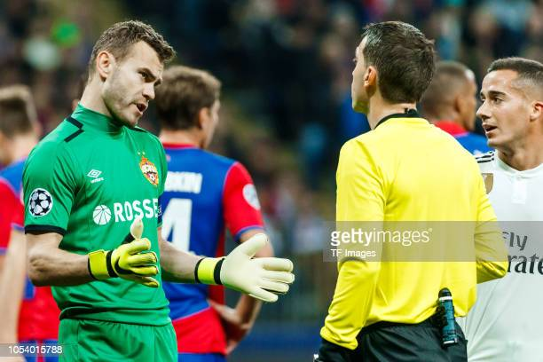 Akinfeev of CSKA Moscow speaks with the referee during the Group G match of the UEFA Champions League between CSKA Moscow and Real Madrid at Arena...