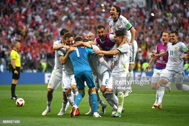 Akinfeev of Russia is celebrated by team mates following the peanlty shoot out during the 2018 FIFA World Cup Russia Round of 16 match between Spain...
