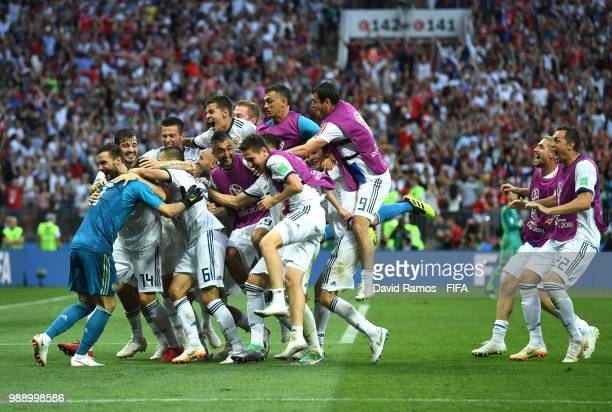 Akinfeev of Russia is celebrated by team mates following the penalty shoot out during the 2018 FIFA World Cup Russia Round of 16 match between Spain...