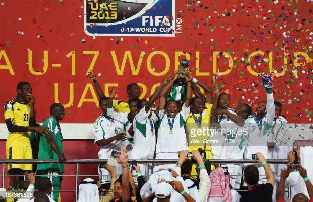 Akinjide Idowu of Nigeria and his team-mates celebrate their victory with the trophy after the FIFA U-17 World Cup UAE 2013 Final between Nigeria and...