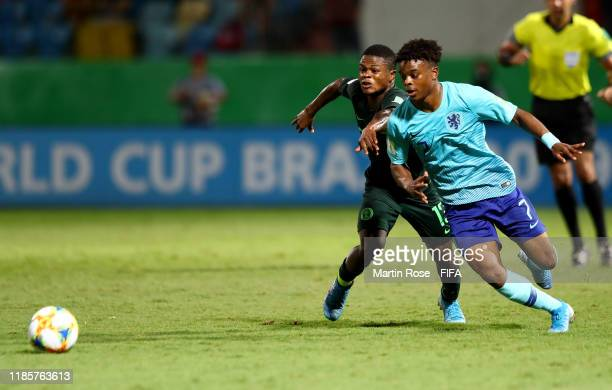 Akinkunmi Amoo of Nigeria challenges Sontje Hansen of the Netherlands during the FIFA U-17 World Cup Brazil 2019 round of 16 match between Nigeria...