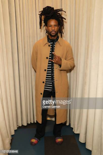 Akinola Davies attends as Jonathan Anderson and Jenny Galimberti celebrate the opening of the new JW Anderson Soho on March 01 2020 in London United...