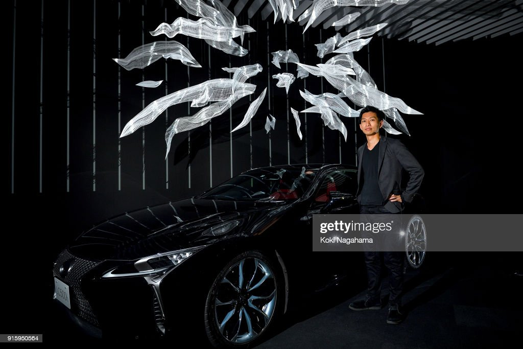 Akinori Goto(Lexus~AKINORI GOTO) poses for a photograph at the Media Ambition Tokyo at Roppongi Hills on February 8, 2018 in Tokyo, Japan. The human body is capable of exquisite movement, the beauty of which lies not only in the act itself but also in its entanglement with the concept of time.For this piece, the artist analyzed data from human motions he considered beautiful, and reconstructed them in three-dimensional form. Each frame is seamlessly weaved together in an attempt to give shape to the invisible concept of time, and aims to capture the relationship, qualities, and beauty of time and motion.The mesh sculpture in mid-air represents a time cluster, and when a beam of light is projected on it, 'motion' appears.The form that extends from the center outward, as if cutting through space, traces the trajectory of human motion, and is designed so impart, upon taking step back for a wider view, an image of a human body in motion. As with the design of LEXUS vehicles, which conveys the fluid nature of time, similarly imbued is the present work, in the way it captures timefs form, beauty, and qualities. When two like minds embark on a journey together, a new kind of creativity is born.