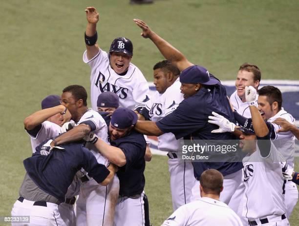 Akinori Iwamura and the Tampa Bay Rays celebrate around Fernando Perez after he scored the winning run in game two of the American League...
