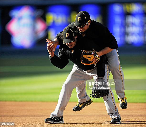 Akinori Iwamura jumps on top of Delwyn Young of the Pittsburgh Pirates during batting practcie prior to the start of the baseball game against Los...