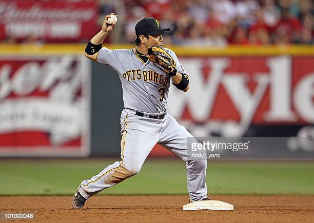 Akinori Iwamura of the Pittsburgh Pirates throws the ball to first base during the game against the Cincinnati Reds at Great American Ball Park on...