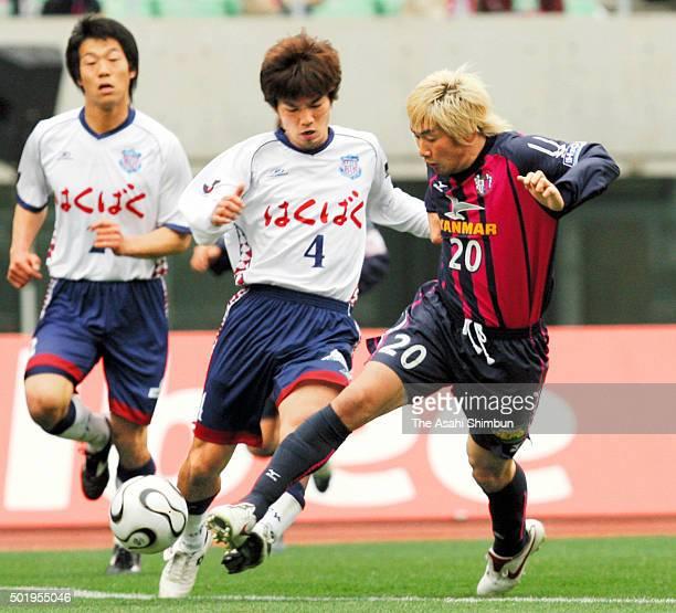Akinori Nishizawa of Cerezo Osaka and Hideomi Yamamoto of Ventforet Kofu compete for the ball during the JLeague match between Cerezo Osaka and...