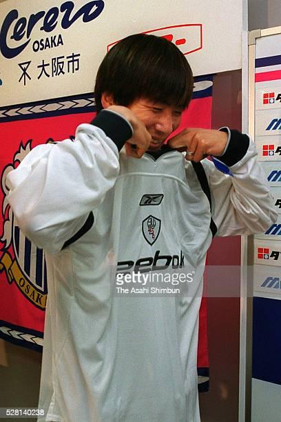 Akinori Nishizawa of Cerezo Osaka wears Bolton Wanderers shirt during a press conference on his loan move on July 18 2001 in Osaka Japan