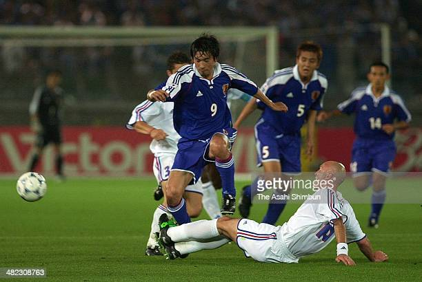 Akinori Nishizawa of Japan is tackled by Frank Leboeuf of France during the 2001 FIFA Confederations Cup final match beween Japan and France at the...
