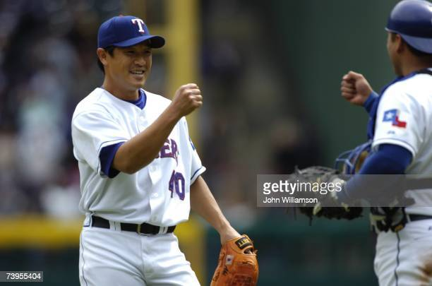 Akinori Otsuka of the Texas Rangers celebrates following the game against the Boston Red Sox at Rangers Ballpark in Arlington in Arlington Texas on...