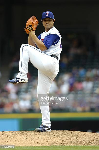 Akinori Otsuka of the Texas Rangers pitches during the game against the Toronto Blue Jays at Rangers Ballpark in Arlington in Arlington Texas on May...