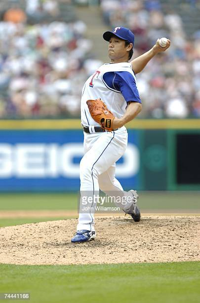 Akinori Otsuka of the Texas Rangers pitches during the game against the Los Angeles Angels of Anaheim at Rangers Ballpark in Arlington in Arlington...