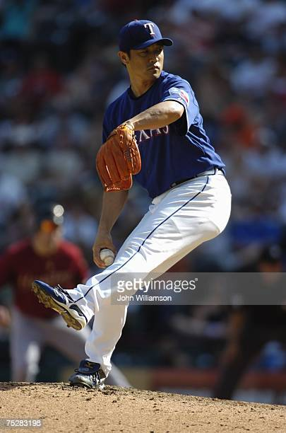 Akinori Otsuka of the Texas Rangers pitches during the game against the Houston Astros at Rangers Ballpark in Arlington in Arlington Texas on June 23...