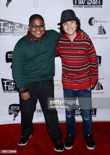 Akinyele Caldwell and Hunter Payton attend The Artists Project Boo2Bullying Toy Drive to Benefit the Los Angeles Fire Department on December 14 2017...
