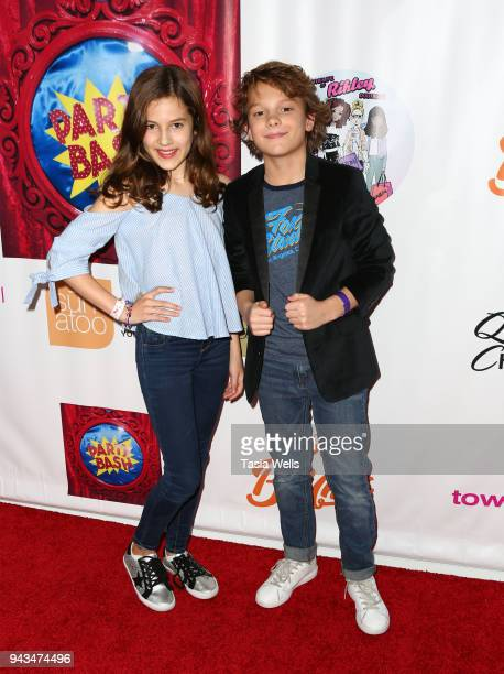 Akinyele Caldwell and Mason Thames attend Spreading the Love event at Starwest Studios on April 7 2018 in Burbank California