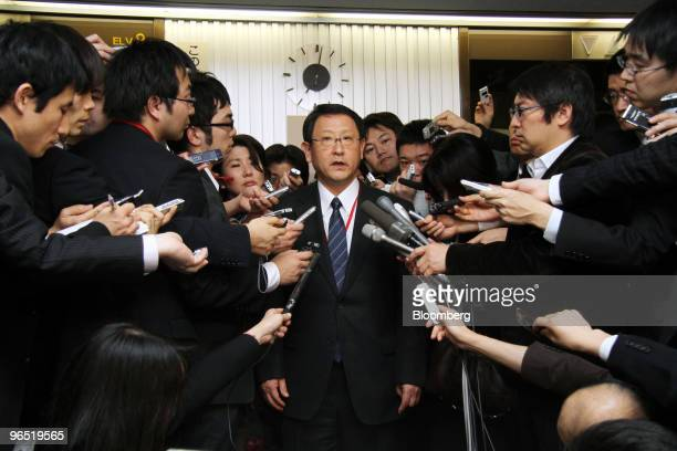 Akio Toyoda president of Toyota Motor Corp is surrounded by journalists after meeting with Seiji Maehara Japan's minister for land and transport at...