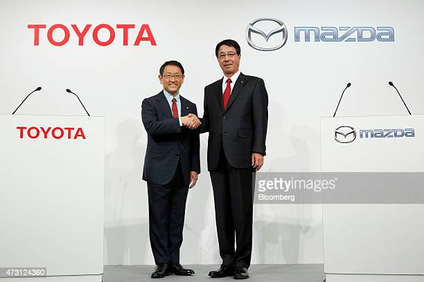 Akio Toyoda president of Toyota Motor Corp left and Masamichi Kogai president of Mazda Motor Corp shake hands during a news conference in Tokyo Japan...