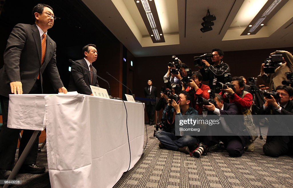 Akio Toyoda, president of Toyota Motor Corp., left, and Shinichi Sasaki, executive vice president of the company, leave a news conference in Nagoya, Japan, on Friday, Feb. 5, 2010. Toyoda apologized for the company's growing recall crisis in his first public appearance since the company halted U.S. sales and production of its best-selling models last month. Photographer: Tomohiro Ohsumi/Bloomberg via Getty Images