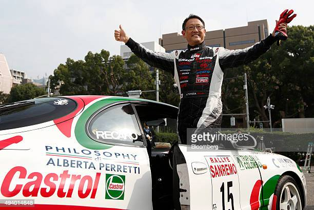 Akio Toyoda president of Toyota Motor Corp poses for photographs while standing on the company's Celica GT four during the 60th Anniversary Tokyo...