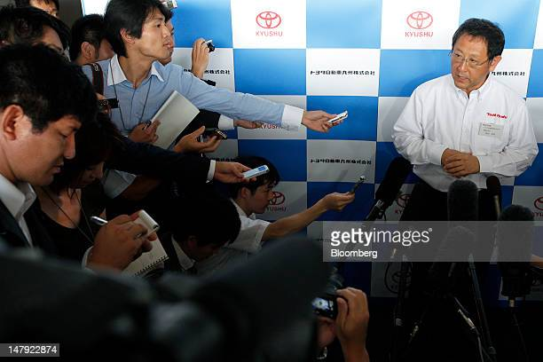 Akio Toyoda president of Toyota Motor Corp right speaks to the media after a lineoff ceremony for the company's Lexus ES series sedans at the Toyota...
