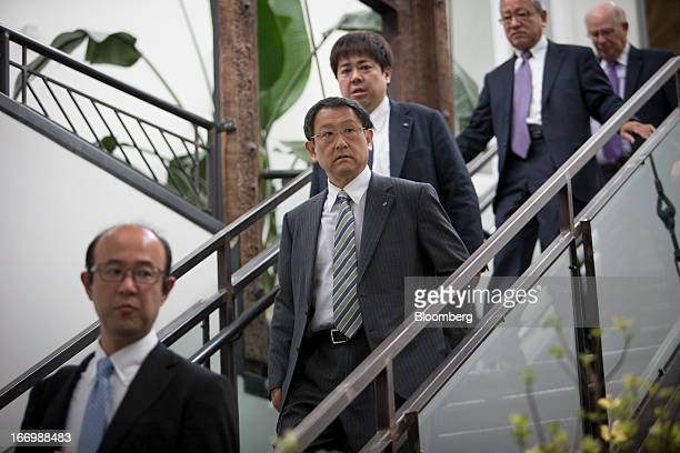 Akio Toyoda president of Toyota Motor Corp second from left descends a staircase before a news conference in New York US on Friday April 19 2013...
